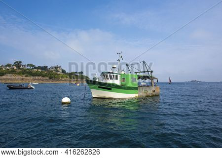 Small Fishing Boat In Shallow Water In Saint-malo, Brittany, France