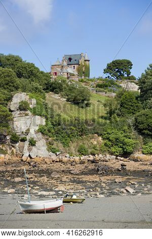 Breha Island, France, July 28: Traditional House And Small Wooden Boats On Brehat Island In Brittany