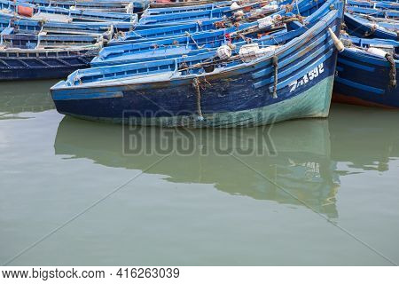 Essaouira, Morocco - August 21: Blue Fishing Boats In The Harbor Of Essaouira 2014. The Old Town Of