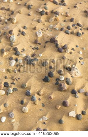 Closeup Of Stones And Sand On The Shore Of Sidi Kaouki, Morocco