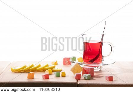 Traditional Turkish Tea, Lemon And Delight On The Wooden Table, Isolated On A White Background