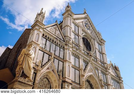 White Marble Facade Of The Famous Gothic Church Of Santa Croce In Florence, Italy, With The Monument
