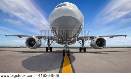 Modern Airliner On A Runway Ready For Take Off