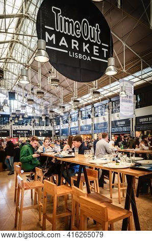 Lisbon, Portugal - February 3, 2019: People Eating At The Tables Of The Time Out Market, Famous Trad