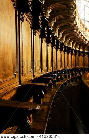 Antique Wooden Choir Seating Stalls In A Baroque Chapel In Italy