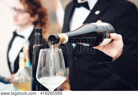 Tasting Experience With A Sommelier Serving A Glass Of Moscato D'asti (muscat) Sparkling Wine In Alb
