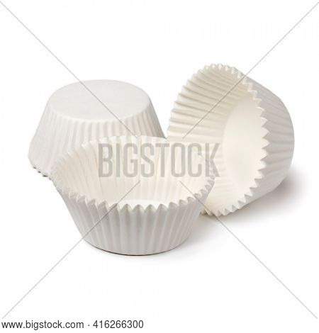 White empty paper cupcake or muffin cups isolated on white background
