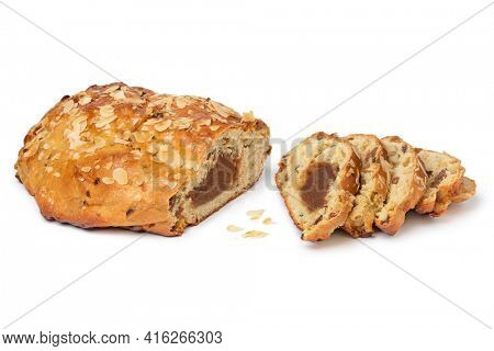 Traditional Dutch homemade easter bread and slices stuffed with almond paste,cinnamon and almonds isolated on white background