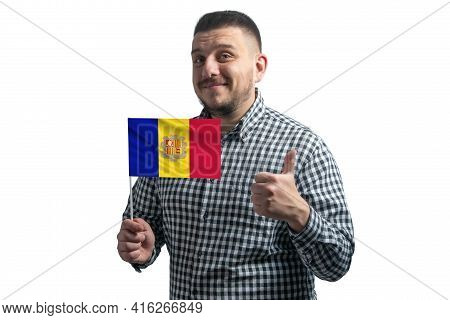 White Guy Holding A Flag Of Andorra And Shows The Class By Hand Isolated On A White Background. Like
