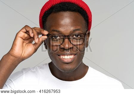 Closeup Portrait Of Young African Hipster Guy With Broad Toothy Smile Isolated On White Background.