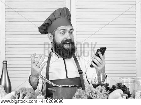 Culinary Education Online. Elearning Concept. Man Chef Searching Internet Recipe Cooking Food. Chef