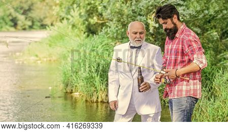 Togetherness. Father And Son Fishing. Male Friendship. Summer Family Weekend. Two Fishermen With Fis