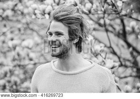 Hipster Enjoy Blossom Aroma. Unshaven Man Sniff Bloom Of Magnolia. Springtime Concept. Man Flowers B