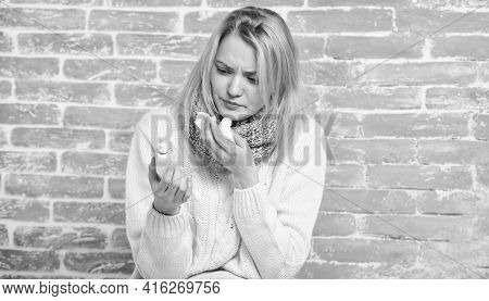 Treating Allergy. Cute Woman Nursing Nasal Cold Or Allergy. Sick Woman Injecting Drops Into Nose. Pr