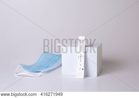 Rapid Coronavirus Test And Medical Mask On The White Background. Negative Test Result By Using Rapid