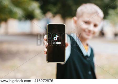 Podolsk, Ukraine - March 29, 2021: Boy Holding Smartphone With Social Internet Service Tik Tok On Th