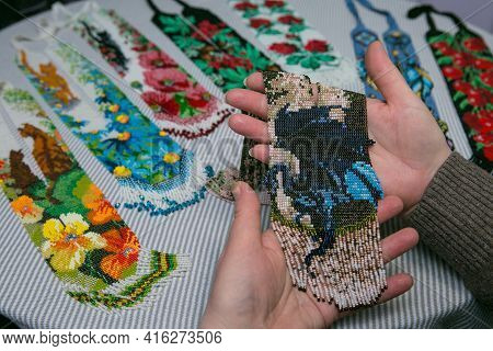 Weaving From Beads. Close-up - Hands Of Women With Ready-made Beads. The Woman Is Fond Of Weaving Fr