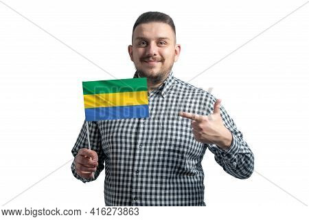 White Guy Holding A Flag Of Gabon And Points The Finger Of The Other Hand At The Flag Isolated On A