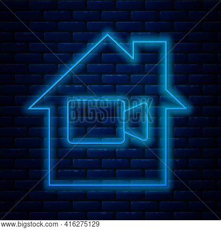 Glowing Neon Line Video Camera Off In Home Icon Isolated On Brick Wall Background. No Video. Vector