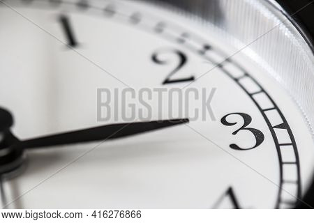 Clock Hand Pointing Three O'clock On White Clock Face Of Twin Bell Classic Alarm Clock