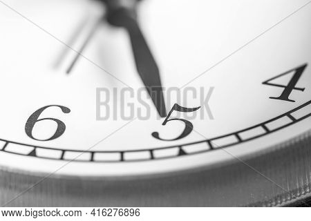 Clock Hand Pointing Five O'clock On White Clock Face Of Twin Bell Classic Alarm Clock