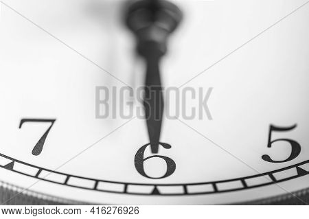 Clock Hand Pointing Six O'clock On White Clock Face Of Twin Bell Classic Alarm Clock