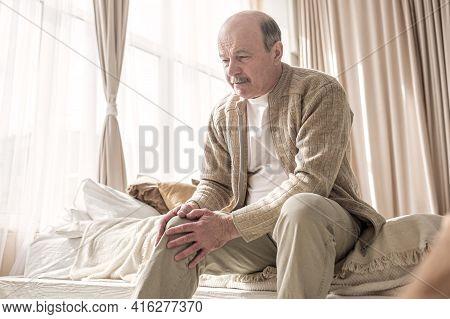 Senior Man With Osteoarthritis Pain Holding Hands On His Knee