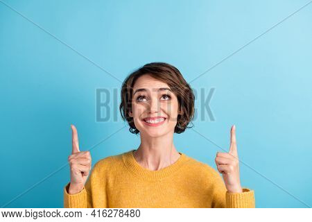 Photo Portrait Of Funny Cheerful Girl With Bob Hairstyle Pointing Up At Copyspace Smiling Isolated O