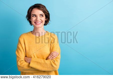 Photo Portrait Of Cheerful Girl With Bob Hairstyle Crossed Hands Smiling Looking At Blank Space Isol