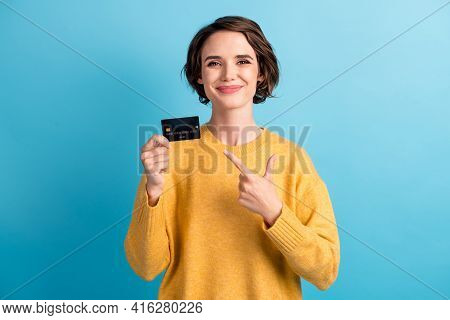 Portrait Of Adorable Sweet Young Bob Hairstyle Lady Pointing Bank Card Wear Yellow Sweater Isolated