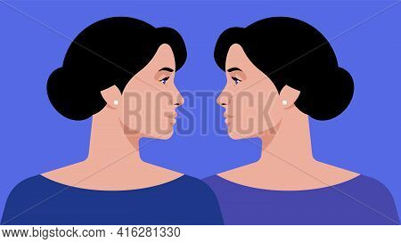 Twins Sisters - Portrait Of Two Identical Women Look At Each Other. Two Beautiful Girls On A Blue Ba
