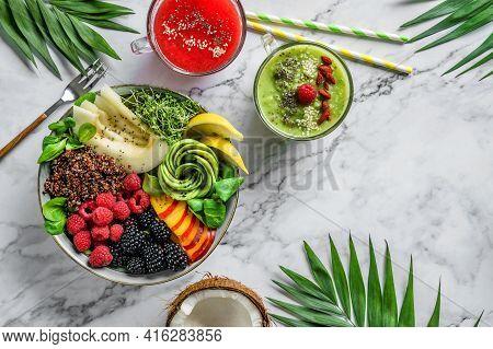 Fresh Summer Salad With Quinoa, Peach, Micro Greens, Avocado, Berries, Coconut, Melon On Light Marbl