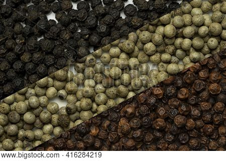 Mix Of Pepperseeds, Red White And Black, Diagonal Food Collage As Background.