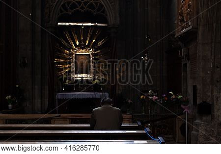 Wien - April 3, 2021: Man Praying On A Pew In A Church