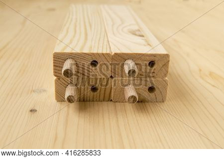Pine Wood Assembly Parts. Bars Have Holes. Сonstruction Fasteners Are Inserted Into Holes.