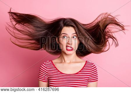 Photo Of Pretty Unsatisfied Person Look Empty Space Hair Flying Grin Tooth Isolated On Pink Color Ba