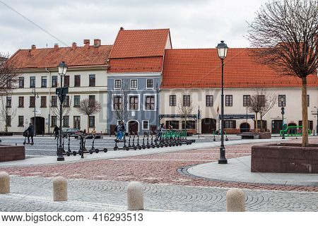 Vilnius, Lithuania - March 28, 2021: Colorful Old Buildings In The Town Hall Square, A Traditional C