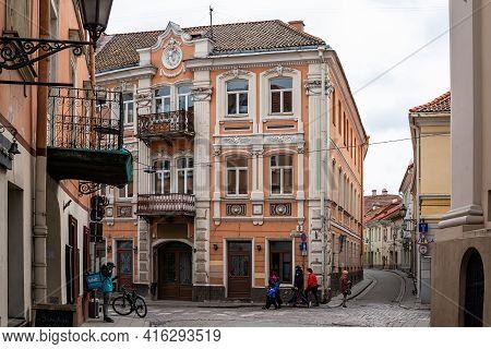 Vilnius, Lithuania - March 28, 2021: Picturesque Street Of Vilnius Old Town - Dominikonu Street. Vil
