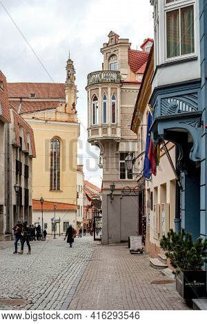 Vilnius, Lithuania - March 28, 2021: Tourists Walk On Pilies Street, The Oldest And Most Flamboyant