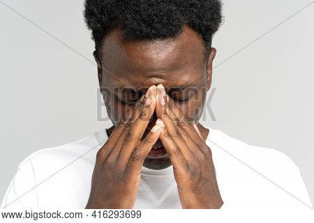 Depressed African Man Portrait. Closeup Of Upset Worried Black Guy With Hands On Face Suffer From So