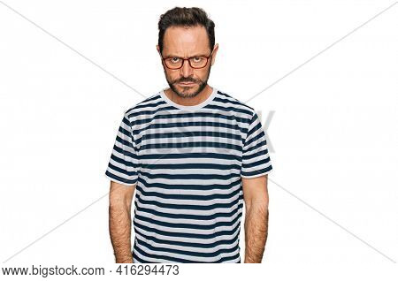 Middle age man wearing casual clothes and glasses skeptic and nervous, frowning upset because of problem. negative person.