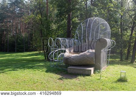 Vilnius, Lithuania - August 31, 2019: Sculpture Chair Pool By Dennis Oppenheim In The Open Air Museu