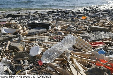 Dump Of Plastic Garbage Pollution On Contaminated Sea Coast Ecosystem, Environmental Waste