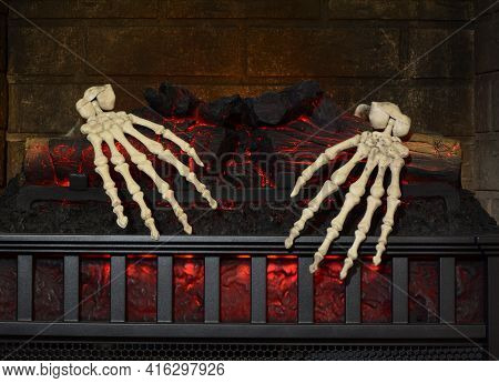 Two Skeleton Hands Grasping Onto Burning Logs In Fireplace