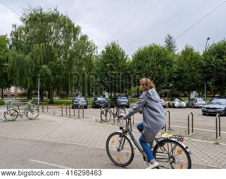 Strasbourg, France - Sep 16, 2017: Side View Of Young Woman Driving A Hercules Bike In Central Stras