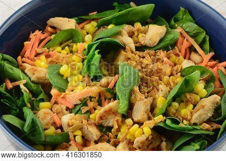 Healthy Spinach Salad In Bowl With Chopped Baked Chicken Breast Pieces, Corn Kernels, Carrots And Cr