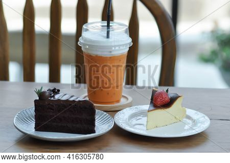 Basque Burnt Cheesecake, Burnt Cheesecake With Strawberry Topping And Chocolate Cake And Milk Tea