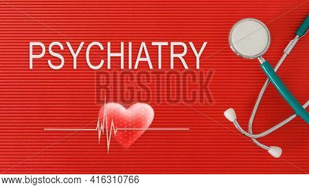 Psychiatry Concept With Stethoscope And Heart Shape On A Red Background