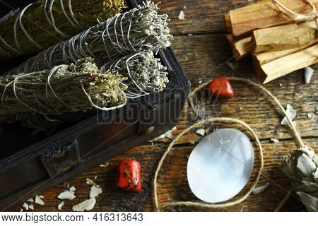 A Close Up Image Of White Sage Smudge Bundles With Selenite And Red Jasper Crystals.