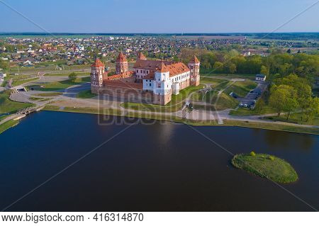The Ancient Castle In A Cityscape On A Sunny April Morning (aerial Photography). Mir, Belarus